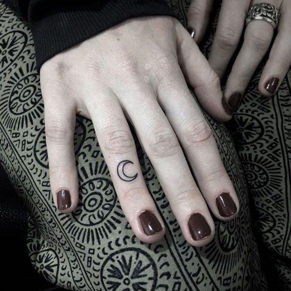 little moon on finger tattoo