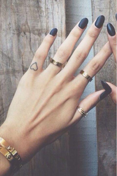 little heart tattoo on finger for women