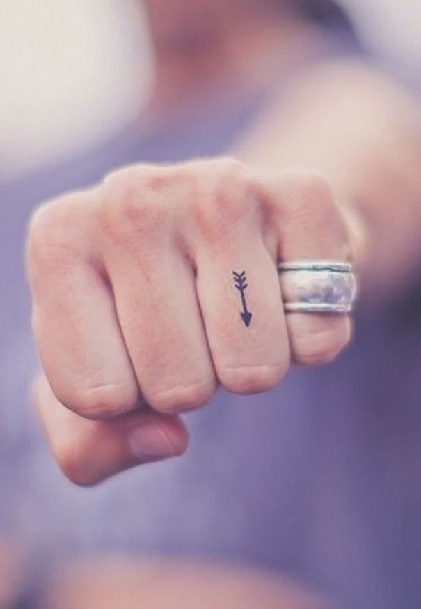 small arrow finger tattoo for strong women