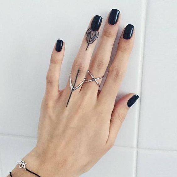 cute and elegant geometrical finger tattoo on hand