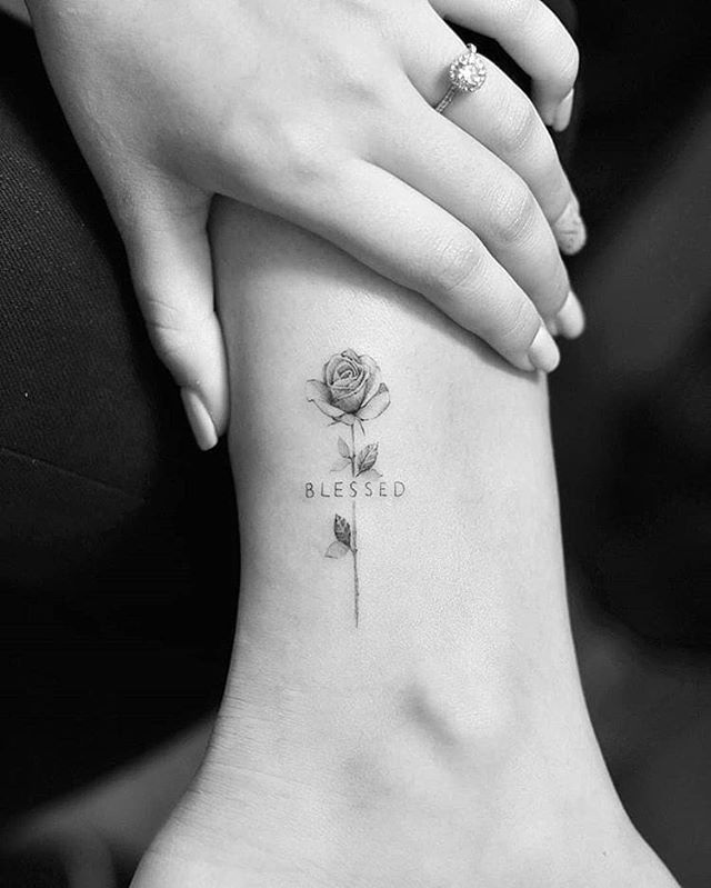 little rose tattoo on ankle with a word, blessed
