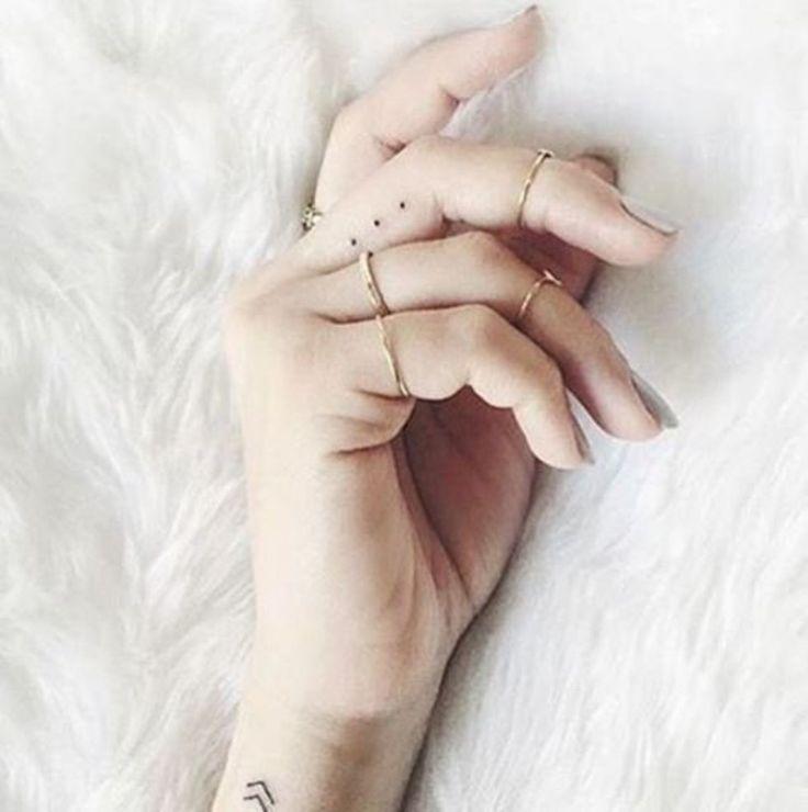 small dots finger tattoos