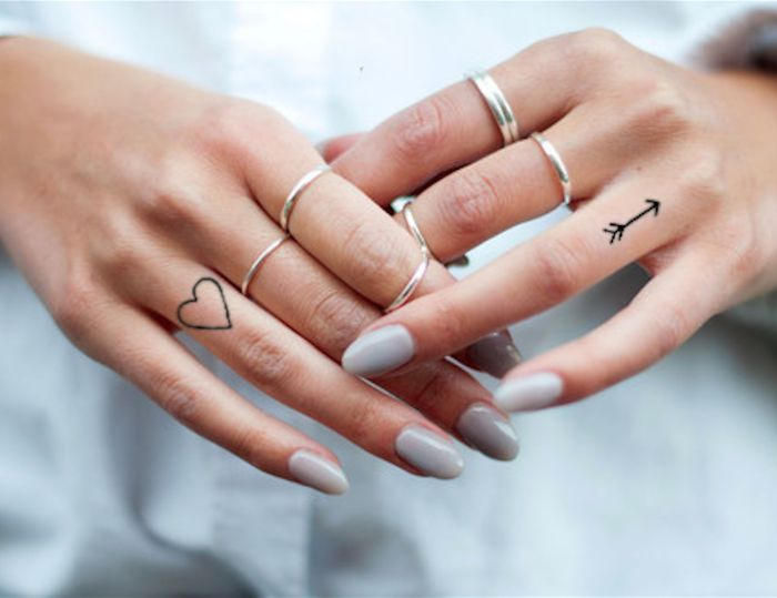 arrow and heart finger tattoos with meaning