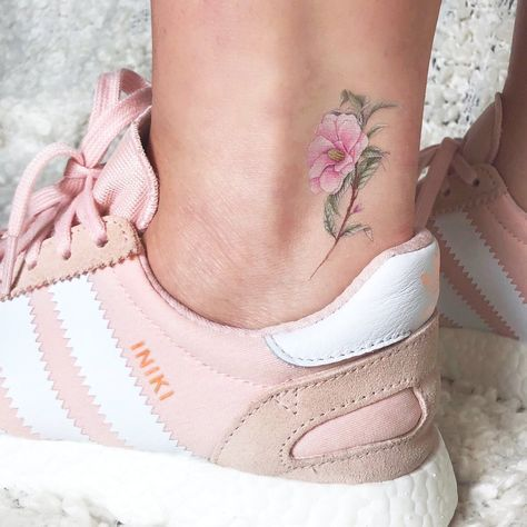 little floreal tattoo on ankle