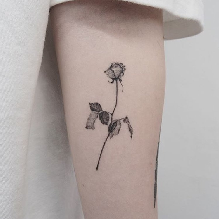 black and white little rose tattoo