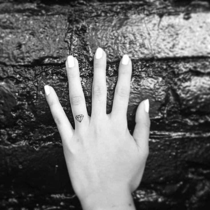 small diamond tattoo on finger