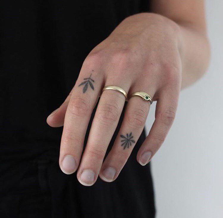 simple plant handpoke tattoo on finger