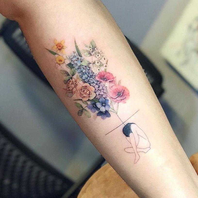 colored flowers tattoo idea forearm