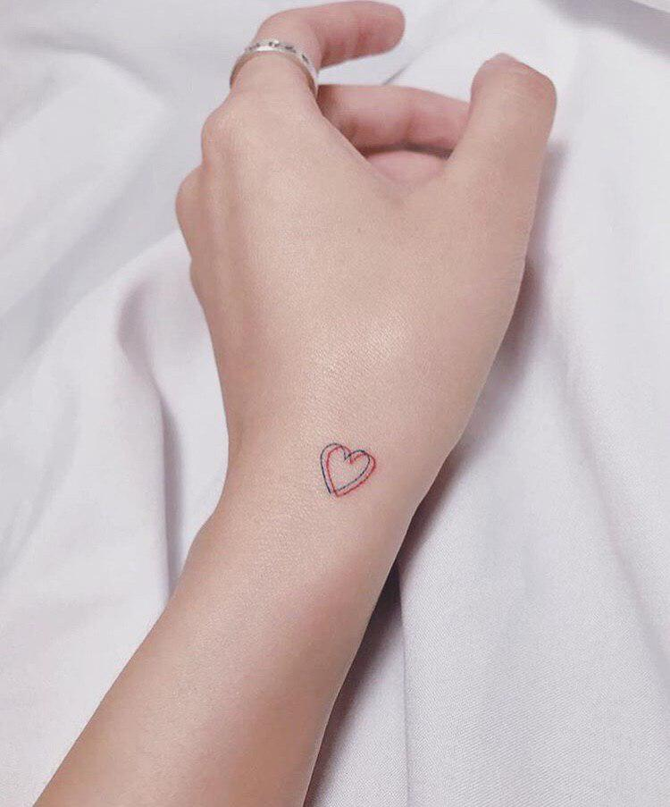 hearth tattoo on wrist