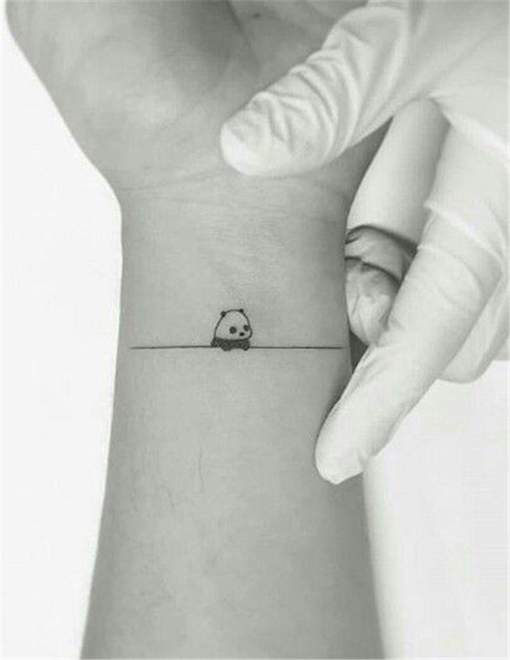 tiny panda wrist tattoo