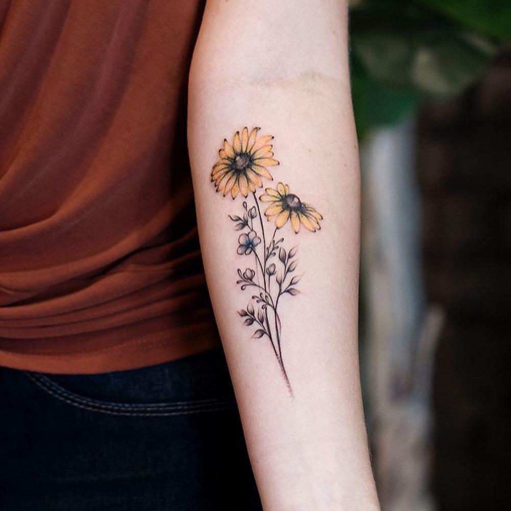 sunflowers tattoo upperarm