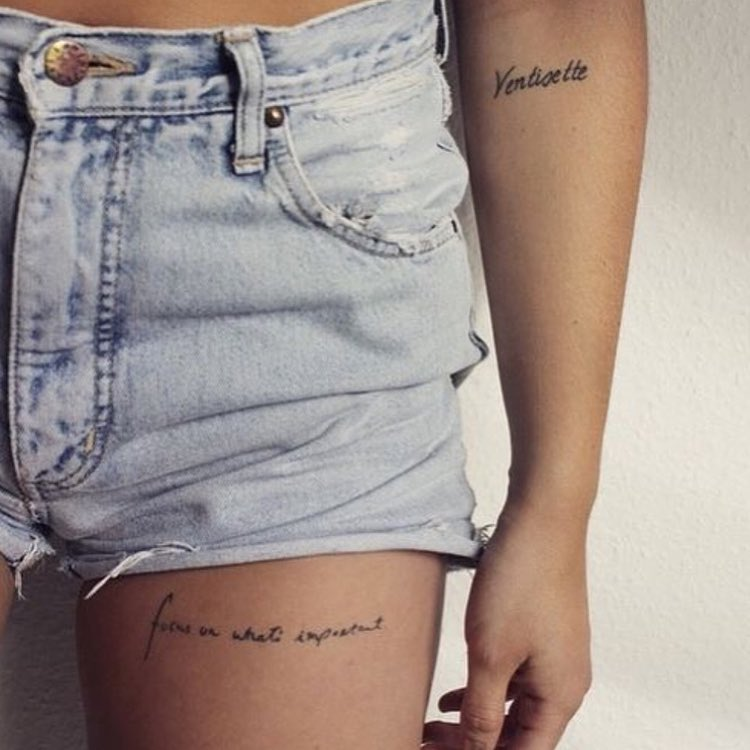 thigh writings tattoo