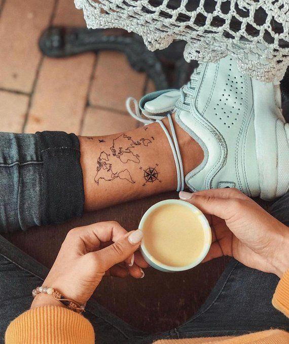 ankle tiny world map tattoo idea
