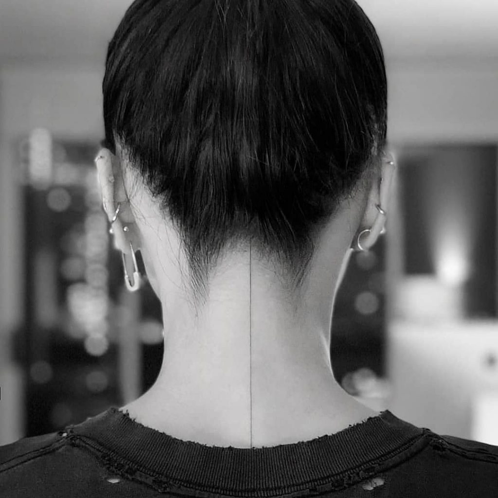 fine line tattoo on neck