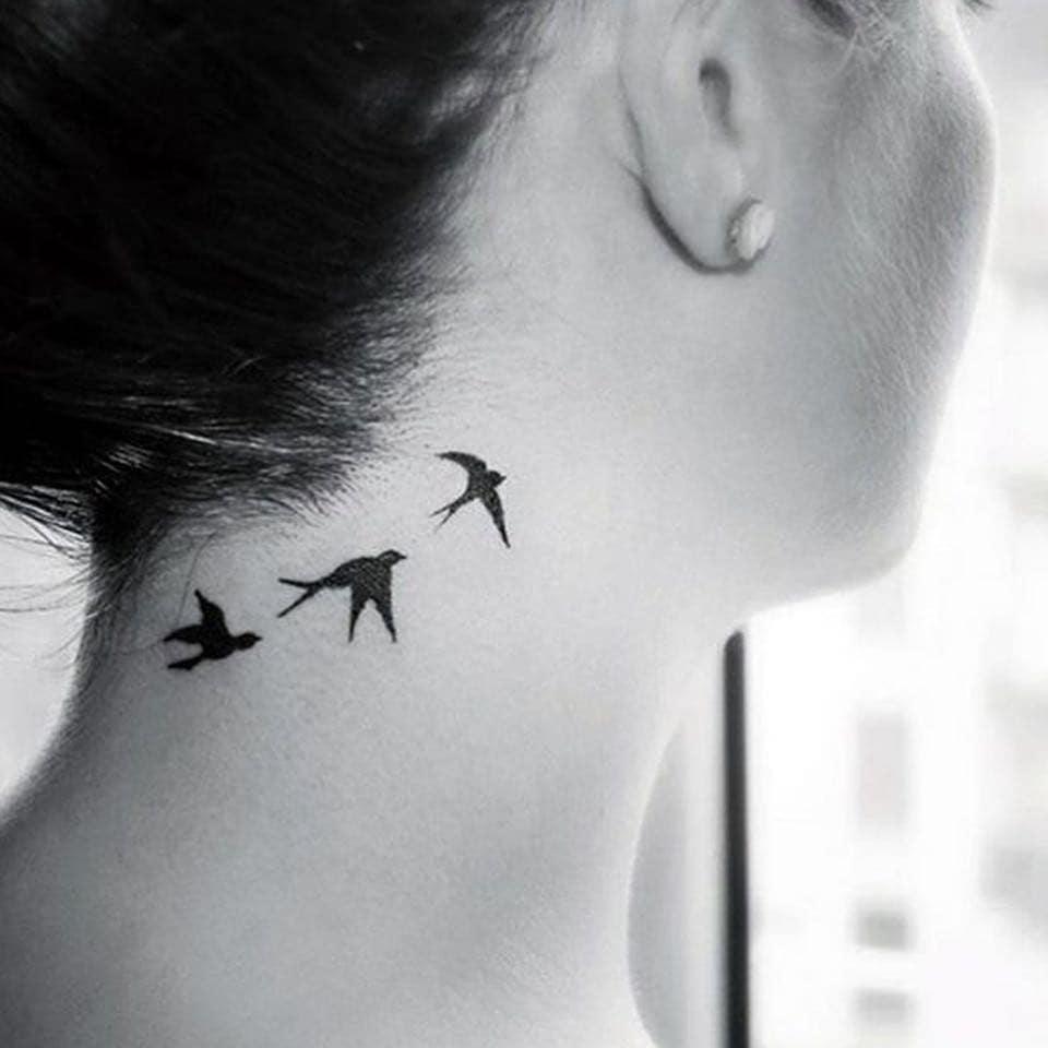 little bird tattoo on neck