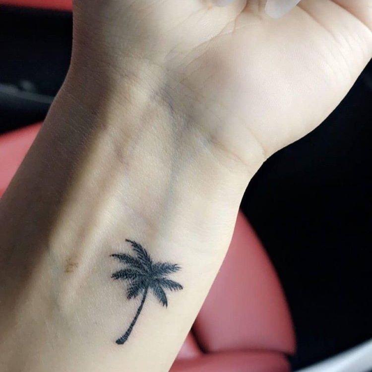 wrist tattoo palm tree