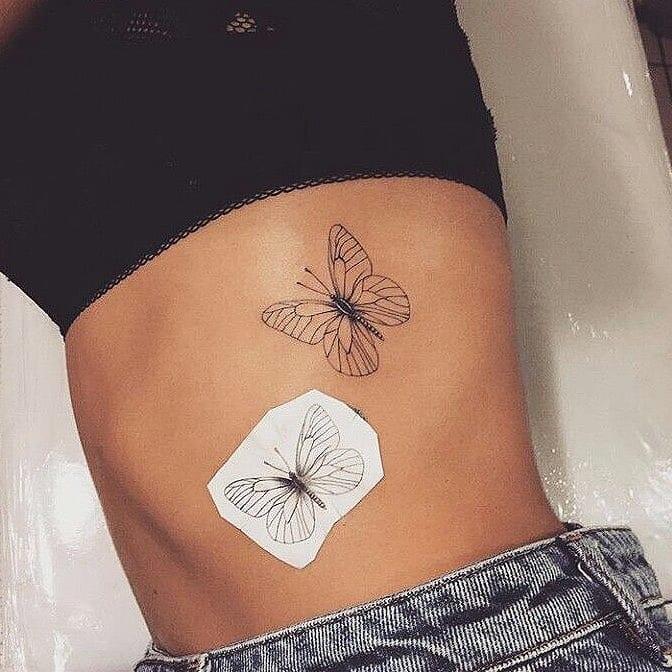 Butterfly ribs tattoo