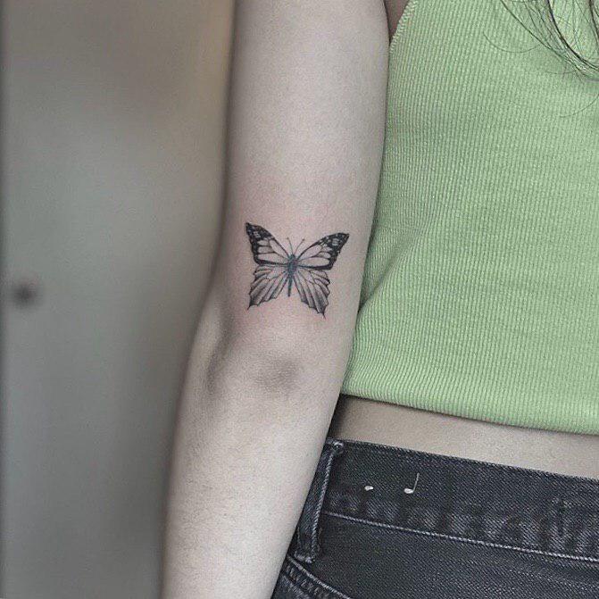 Minimal butterfly tattoo idea