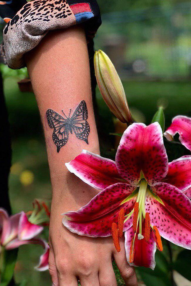 Nature butterfly tattoo with flowers