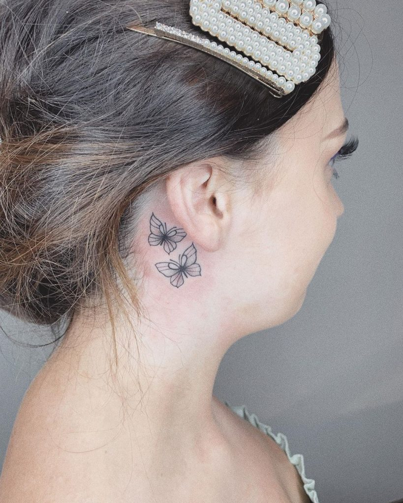 small butterflies tattoos on ear