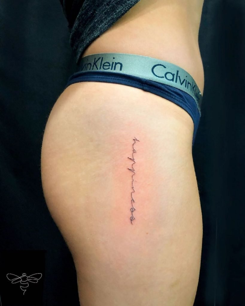 happiness upper side thigh script tattoo