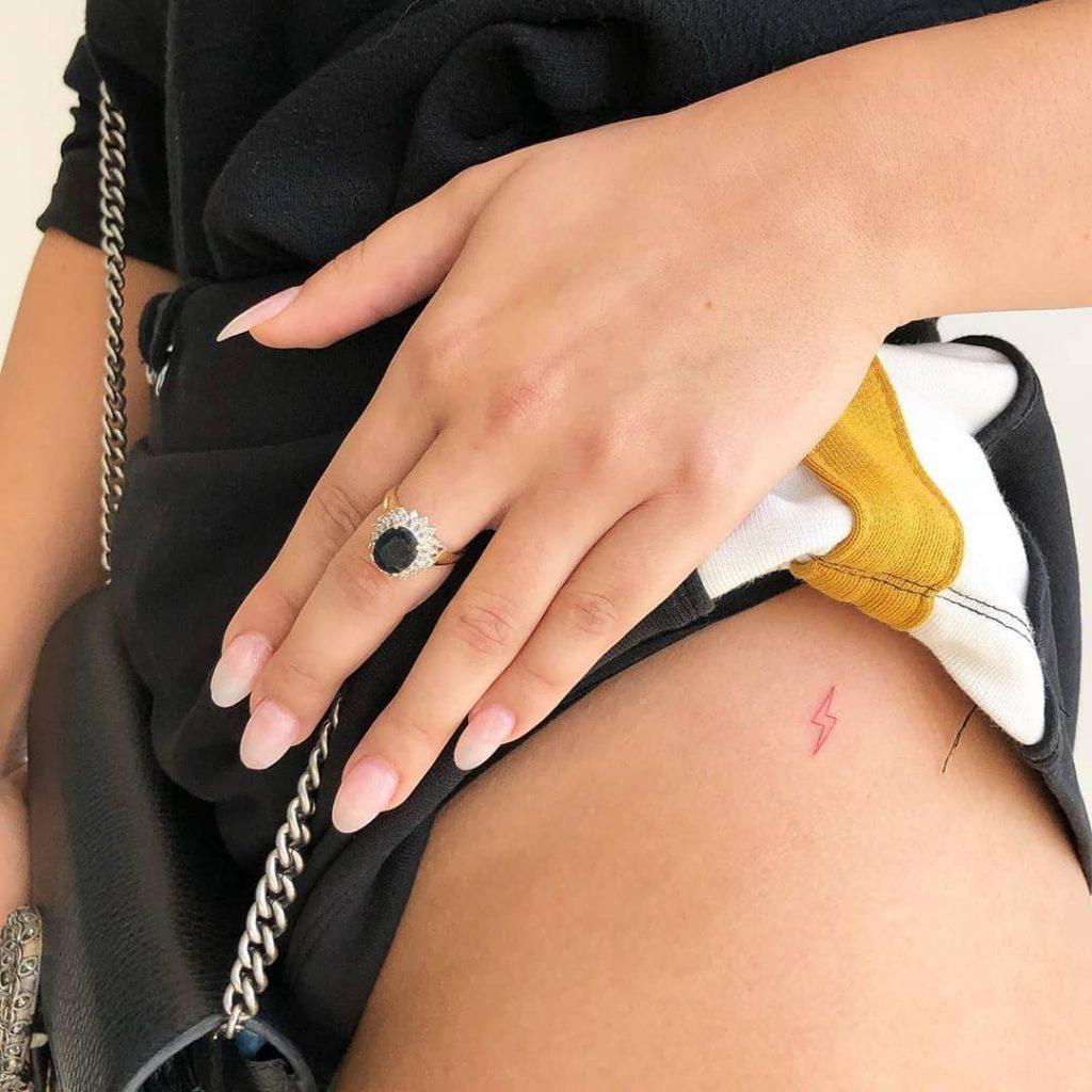 little zap tattoo on hip