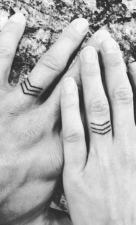 unique wedding ring tattoos with arrows